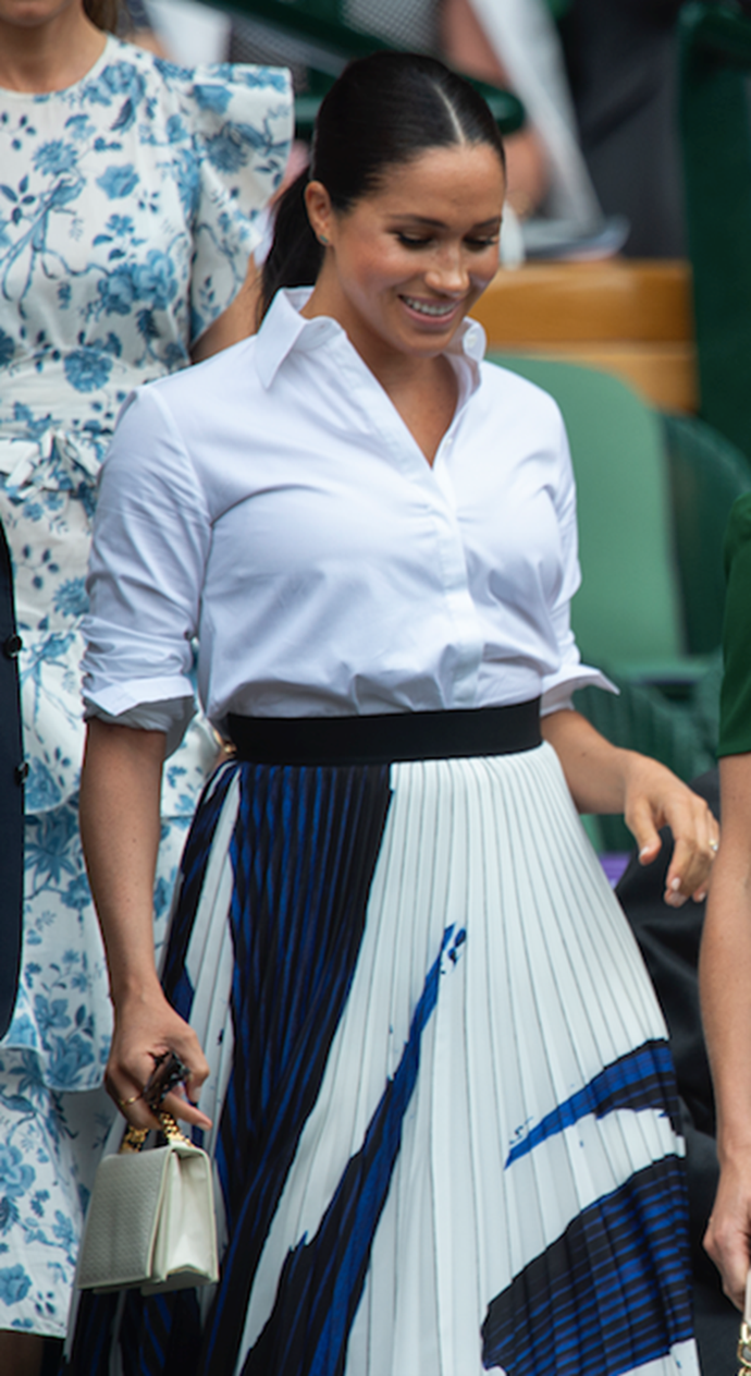 "Meghan attended the Wimbledon women's singles final in July ([with sister-in-law Duchess Catherine](https://www.nowtolove.com.au/royals/british-royal-family/meghan-markle-kate-middleton-wimbledon-2019-57027|target=""_blank""), no less!) wearing this beautiful white Givenchy shirt paired with a printed Hugo Boss pleated midi skirt. Nailed it!"
