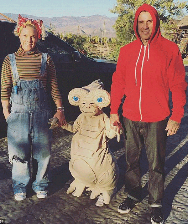 """Pink, alongside her daughter, Willow and husband, Carey Hart were Halloween """"family goals"""" in 2015, as they dress as characters from *E.T. the Extra-Terrestrial*. I mean, just look at Willow in that E.T. costume!"""