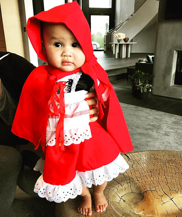 """And Luna in a *Little Red Riding Hood* dress.  """"I'll take this as a no,"""" Chrissy captioned the pic."""