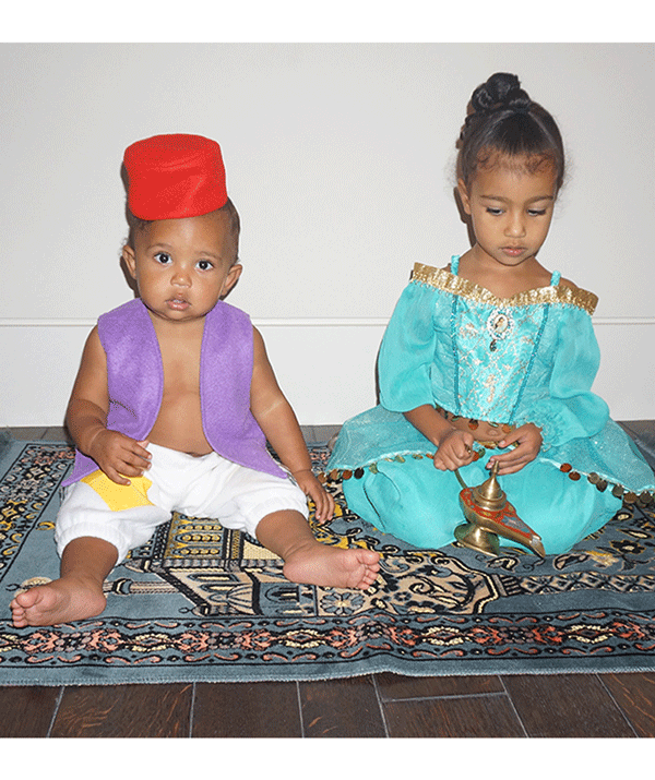 Kim Kardashian's children, Saint and North dressed as Aladdin and Princess Jasmine for Halloween 2016. They are even sitting on a magic carpet! Gah, so cute!