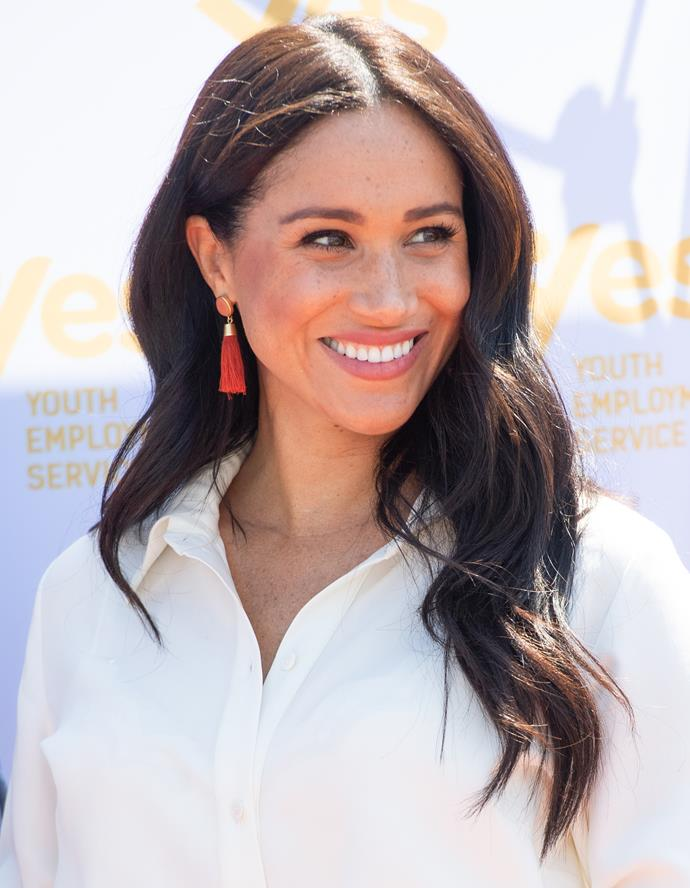 Meghan's orange earrings were chic *and* affordable.