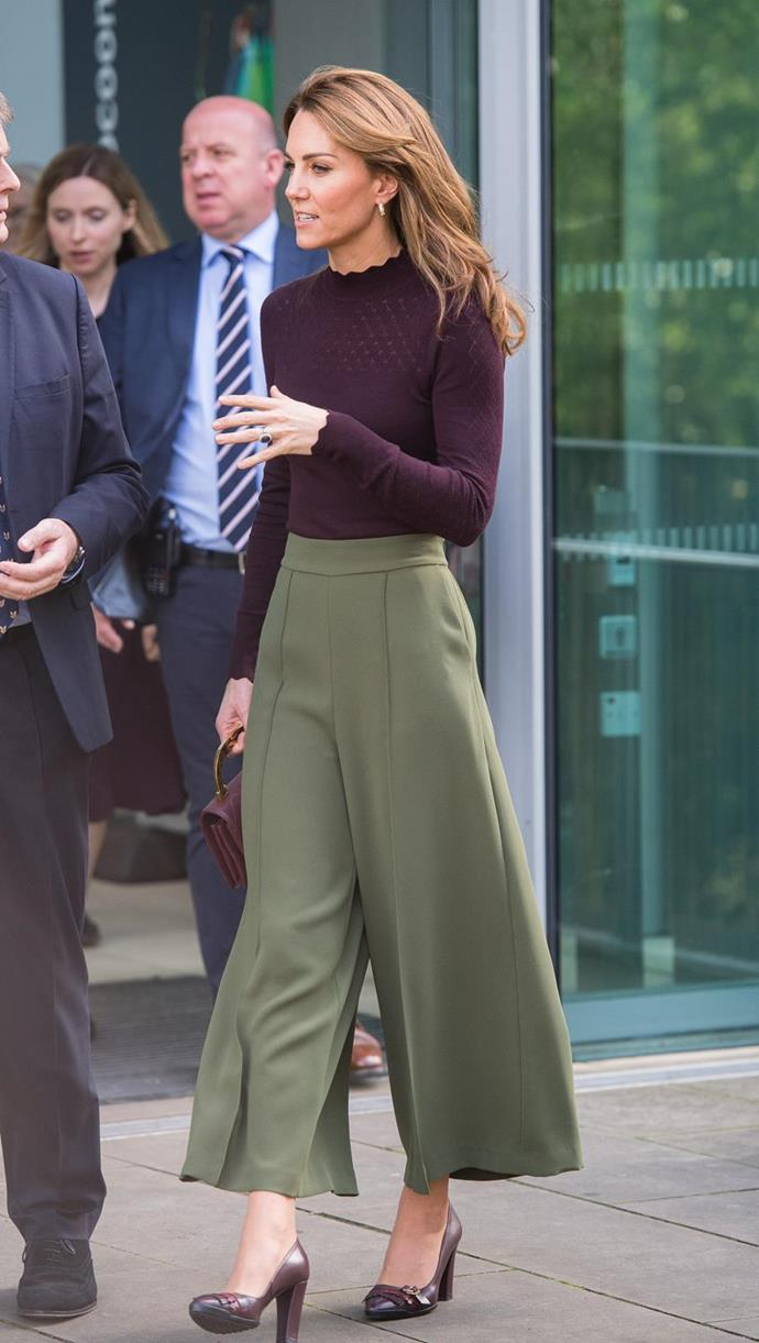 "As Autumn arrived, so did an array of autumnal hues in Kate's enviable wardrobe. For her visit to London's Natural History Museum the royal opted for a [Warehouse fine knit jumper](https://www.nowtolove.com.au/women-of-the-future/the-weekly/kate-middleton-green-pants-59674|target=""_blank""), which featured a high neckline and subtle embroidery detailing. She paired the style with some chic wide-legged khaki pants by Jigsaw."