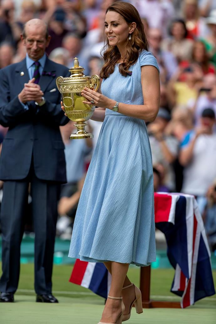 "For the men's singles final during the Wimbledon championships, Kate wore this beautiful blue Emilia Wickstead [crepe dress](https://www.nowtolove.com.au/fashion/fashion-news/kate-middleton-wimbledon-shoes-57122|target=""_blank"")."