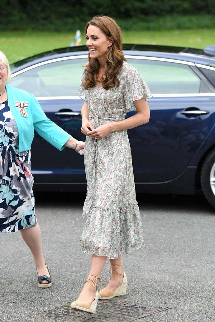 "In June, Kate wore this gorgeous summery frock by [Ridley London](https://www.nowtolove.com.au/royals/british-royal-family/kate-middleton-photography-patronage-56624|target=""_blank"") with a pair of wedge heels - the shoe Kate can't seem to get enough of!"