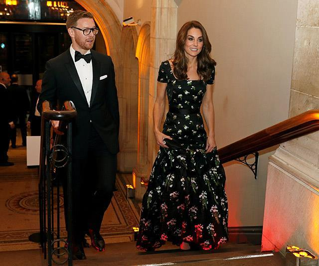 "Later that same day in March, Kate stepped out again in a beautiful [Alexander McQueen gown](https://www.nowtolove.com.au/royals/british-royal-family/kate-middleton-portrait-gala-54602|target=""_blank""), one which looked *very* similar to a gown she previously wore to the BAFTA awards a few years back. This time, small tweaks such as capped sleeves and a slightly varying pattern convinced many that Kate in fact, owned *two* variations of the heavenly McQueen dress."