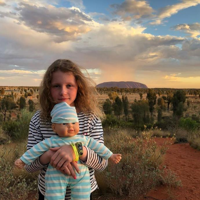 Angela's daughter Amelia poses in front of Uluru.