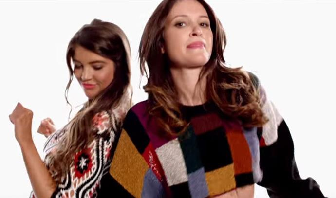 Anna and Mina dance in their Cosby Sweaters.