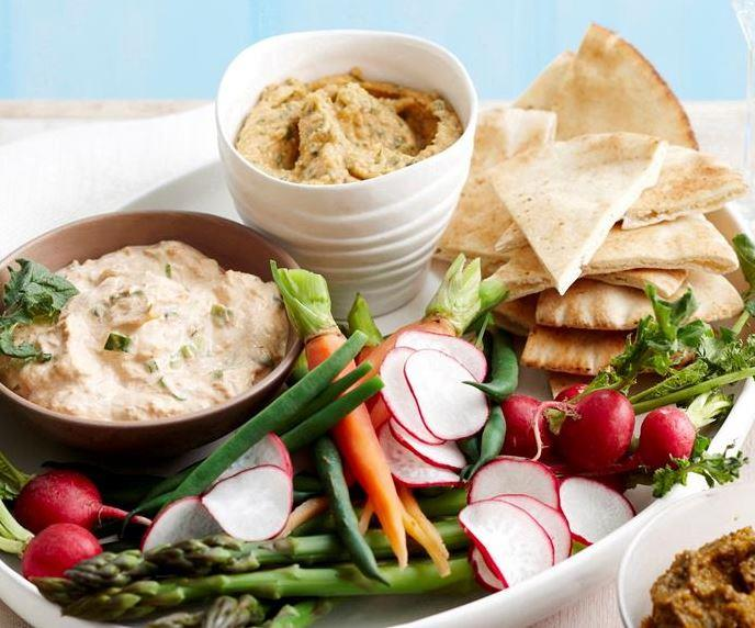 """With a chilli tuna dip, chunky cashew flavour and mint hummus, you'll wow guests with this homemade **dip platter**. [Get the recipes here.](https://www.womensweeklyfood.com.au/recipes/dip-platter-17855