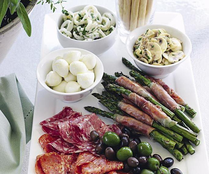 """Delight your guests with an irresistible assortment of **antipasto goodies** waiting to be gobbled up over a glass of wine. [Get the recipe here.](https://www.womensweeklyfood.com.au/recipes/antipasto-plate-27303