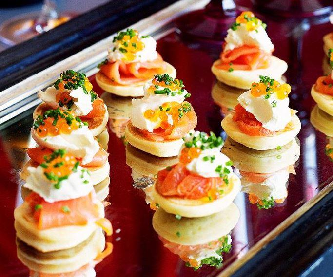 """These light and fluffy **blinis with smoked salmon** make the ultimate dinner party starter or appetiser. [Get the recipe here.](https://www.womensweeklyfood.com.au/recipes/blinis-with-smoked-salmon-11502