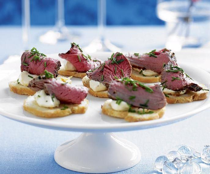 """This **rare-peppered beef and horseradish on garlic crostini** is the ultimate elegant appetiser. [Get the recipe here.](https://www.womensweeklyfood.com.au/recipes/rare-peppered-beef-and-horseradish-on-garlic-crostini-23511