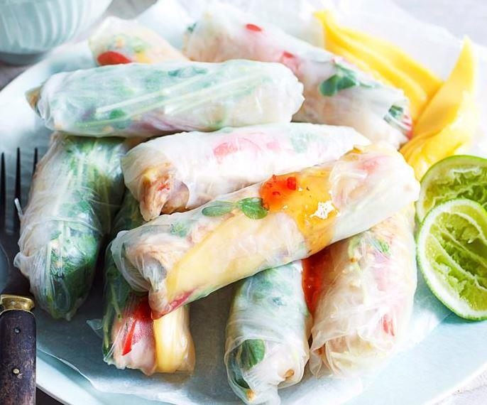 """These light, refreshing **chicken and mango rice paper rolls** served with a zesty chilli lime dipping sauce will be a real crowd-pleaser. [Get the recipe here.](https://www.womensweeklyfood.com.au/recipes/chicken-and-mango-rice-paper-rolls-28055
