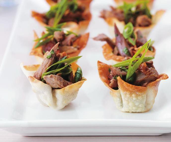 """Crunch through these crisp wonton wrappers to the juicy duck filling inside. A classic Chinese dish, these **duck wonton cups** are perfect for a light lunch or entree. [Get the recipe here.](https://www.womensweeklyfood.com.au/recipes/duck-in-crisp-wonton-cups-6794