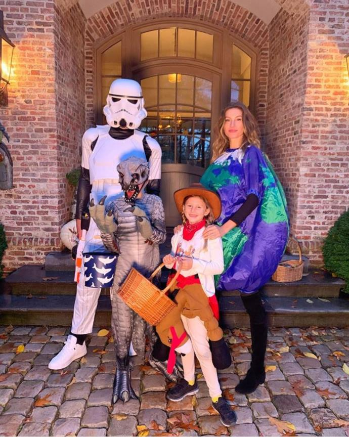 A Storm Trooper, a dinosaur, a cowgirl and...the Earth? Gisele Bündchen and husband Tom Brady along with their kids look like an eclectic bunch.