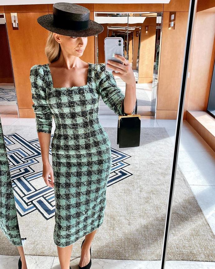 Anna Heinrich is wearing a green and black houndstooth dress by Atoir and on-trend wide-brimmed hat by Lisa Tan.