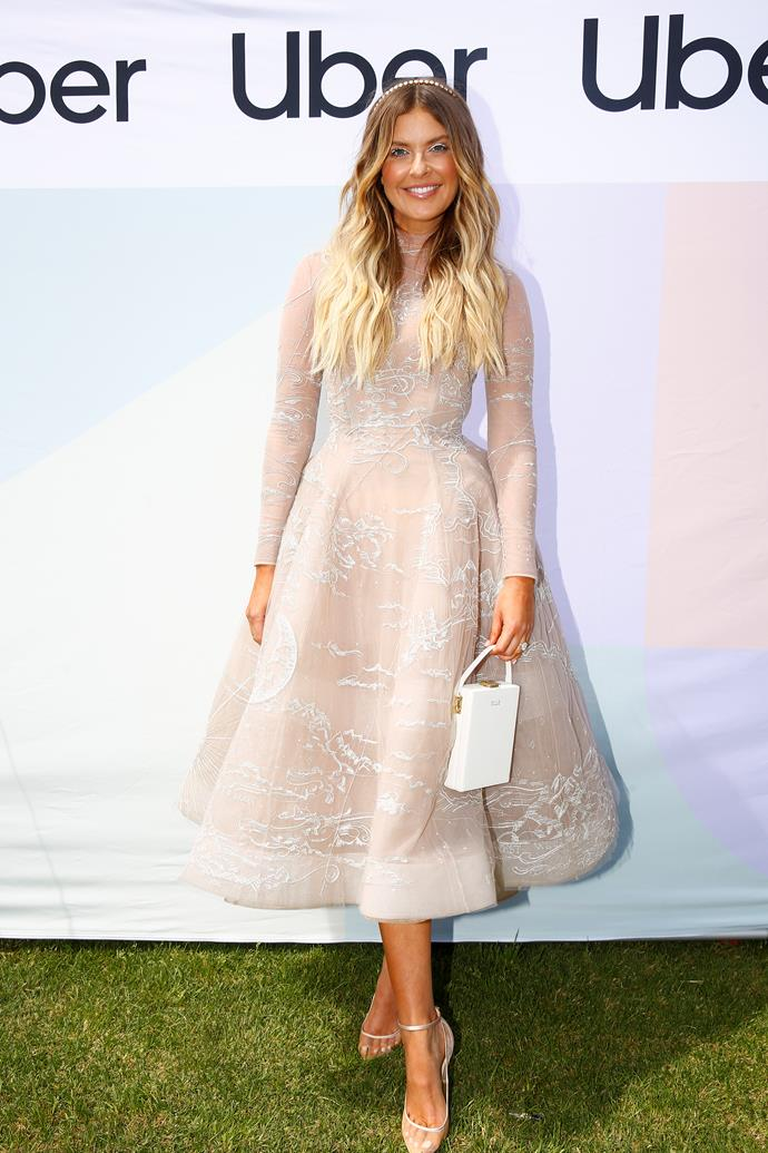 Style maven Elle Ferguson is almost ethereal in this delicate, light number.