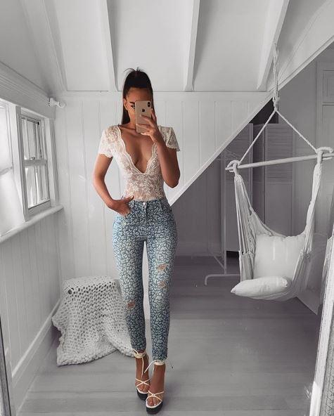 Emma snaps a mirror selfie in her room.