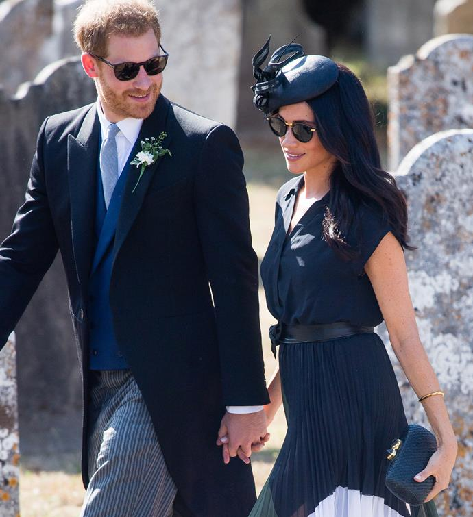 Duchess Meghan clearly thinks it's OK! She's pictured here with Prince Harry at a friend's wedding in 2018.