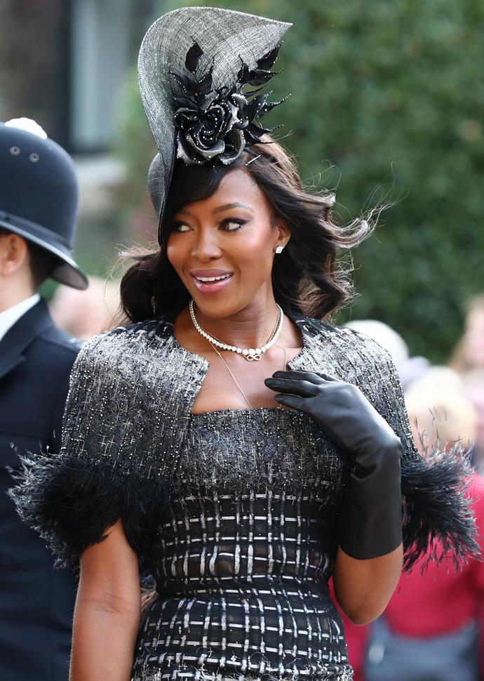 Naomi looked stunning, teaming her black-and-white dress with a black headpiece and black gloves.