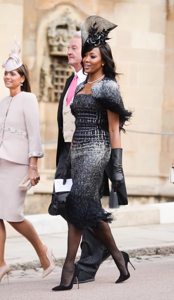 Naomi Campbell wearing a chic black outfit to Princess Eugenie's wedding to Jack Brooksbank in 2018.
