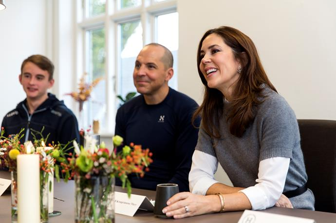The Danish royal engaged in discussions about students' learning capabilities at Danish Continuation Schools.