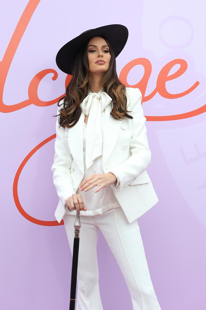 Model Nicole Trunfio is *slaying* the fashion stakes today - right down to the slick cane. Obsessed.
