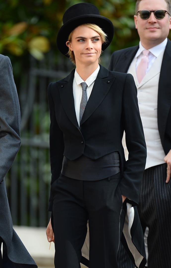 British model and actress Cara Develgine looked awesome in this suit at Princess Eugenie's royal wedding too Jack Brooksbank in 2018.