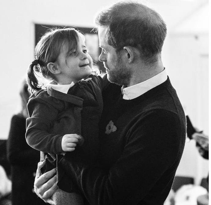 Sussex Royal also shared this sweet black and white candid snap of the royal dad.