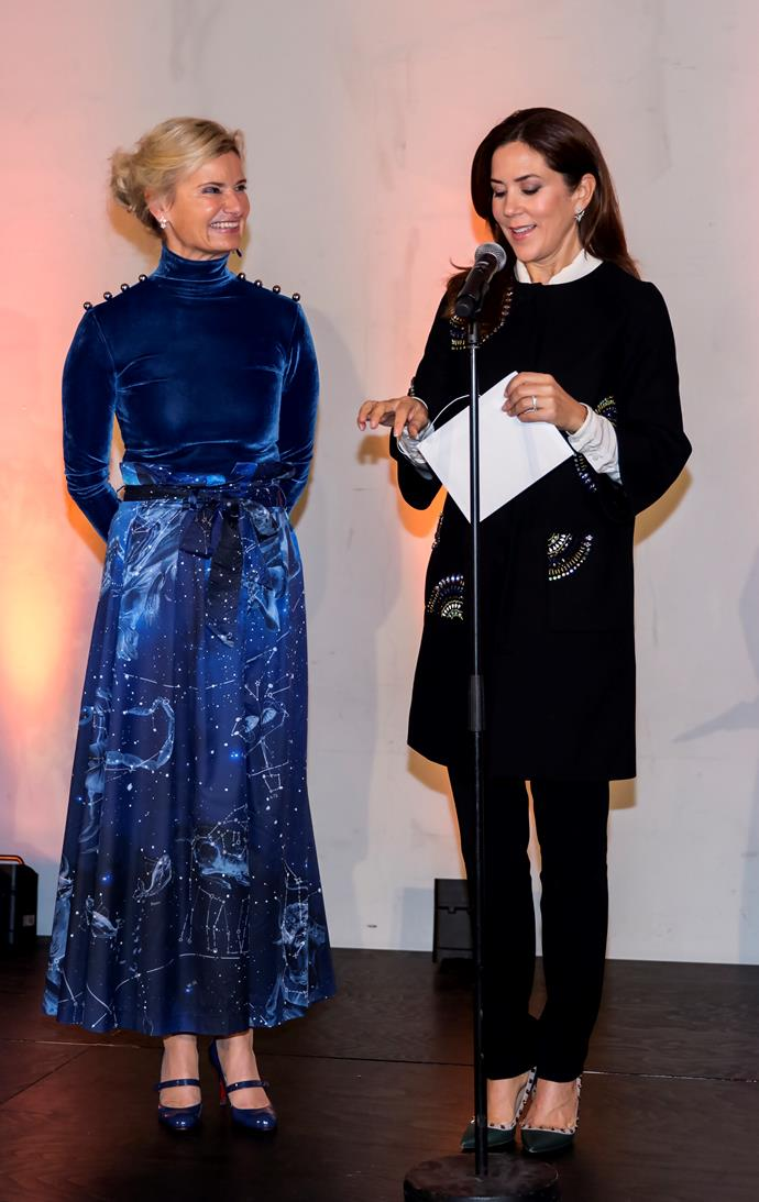 Mary's coat and trousers ensemble was all kinds of chic at the fashionable event.