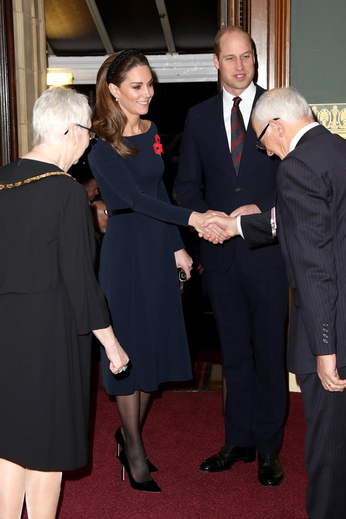 Kate looked gorgeous in a navy blue midi-dress.
