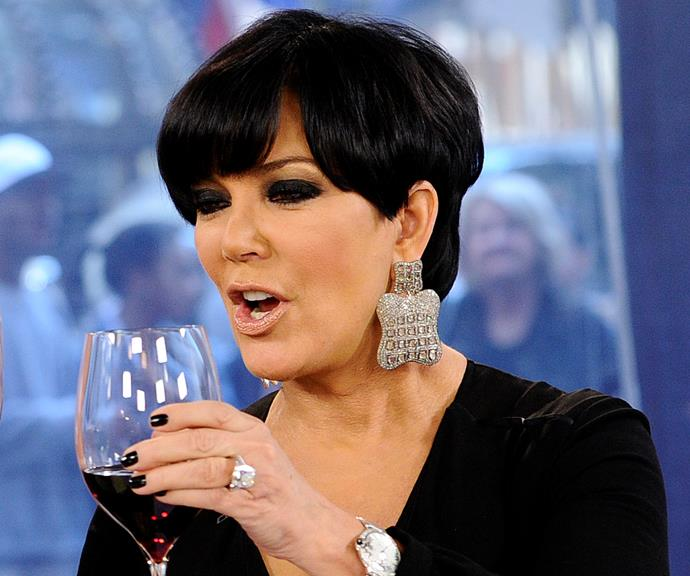Kris Jenner enjoying a glass of red wine.