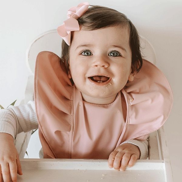 "[Snuggle Hunny Kids bib](https://www.snugglehunnykids.com.au/ballerina-snuggle-bib-waterproof|target=""_blank""