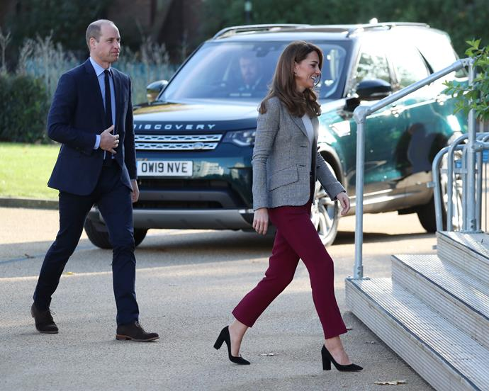 Kate looked completely chic in her grey Smythe blazer and maroon trousers.