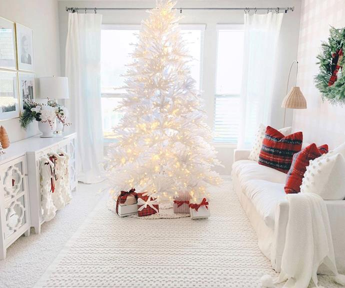 This white Christmas tree sticks with the theme of this pristine room.