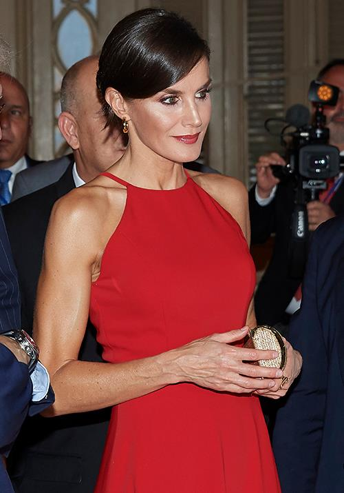 """Wearing her hair in a [chic up-do](https://www.nowtolove.com.au/beauty/hair/royal-up-do-hairstyle-56281 target=""""_blank"""") and finishing her look with a pair of delicate earrings, the regal Queen was oozing glamour."""