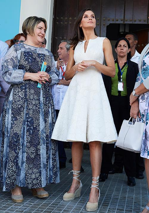 That same day, the Queen of Spain wore this beautiful white frock featuring a classic A-line silhouette, along with a pair of trusty (and comfy) wedge heels. We're getting plenty of European summer vibes here.