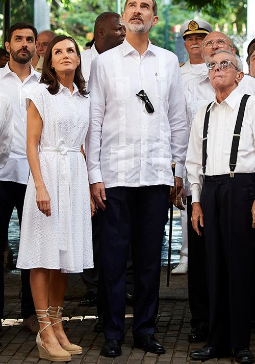 On the second day of the tour, Letizia opted to wear a white broderie shirt dress - again pairing the summery look her favourite wedge heels.