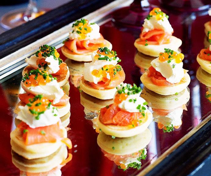 "**Blinis with smoked salmon** <br><br> These light and fluffy mini savoury pancakes make the ultimate dinner party starter or appetiser, and are divine served with a dollop of fresh cream, and tender smoked salmon. <br><br> *See the full Australian Women's Weekly recipe [here](https://www.womensweeklyfood.com.au/recipes/blinis-with-smoked-salmon-11502|target=""_blank""