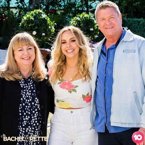Angie with her mother, Jane, and father, Markos, on *The Bachelorette.*