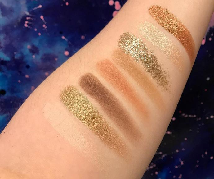 All of the shades in the eyeshadow palette swatched on Tanya's arm.
