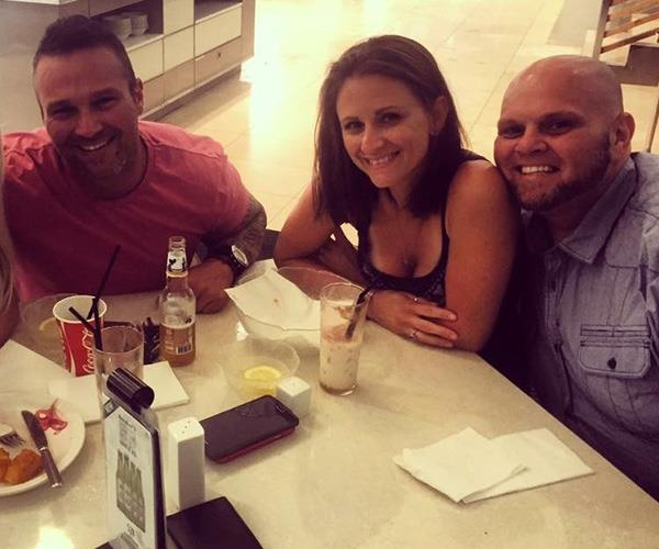 Adro (left) with his brother Mikele and his wife Amanda, who is now said to be engaged to the *Biggest Loser* star.
