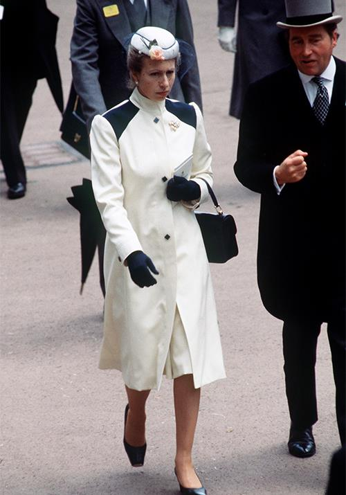 Attending Royal Ascot in 1980, Anne's trendy white and navy coat was glamorous as ever.