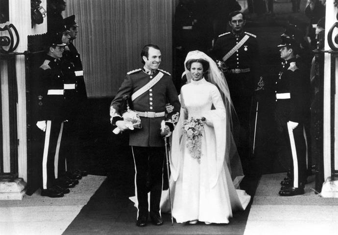 In one of the biggest weddings of the decade, Anne married captain Mark Phillips in 1973 wearing a gorgeous high-neck wedding dress featuring long flared sleeves.