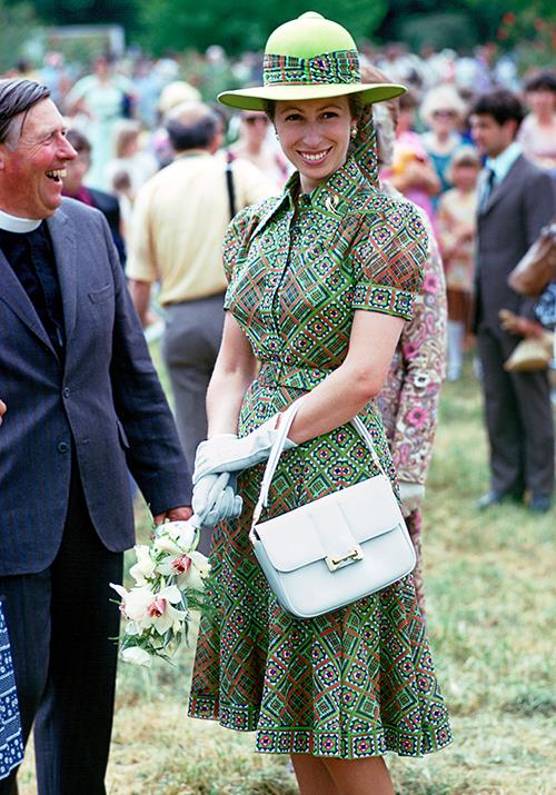 "In 1975, Anne went fashionably rogue wearing this bright printed green shirt dress. [Meghan Markle](https://www.nowtolove.com.au/royals/british-royal-family/meghan-markle-africa-fashion-58378|target=""_blank"") eat your heart out!"