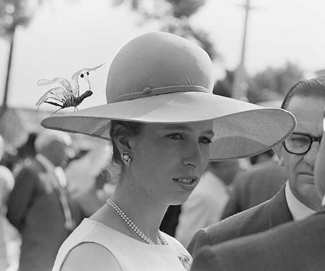 While on a visit to Australia that same year, Anne wore this unusual hat adorned with a giant fake insect.