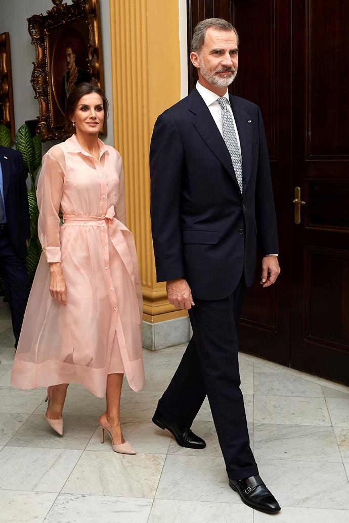In another knockout look, Letizia opted for this beautiful salmon shirt dress featuring a delicate sheer fabric.