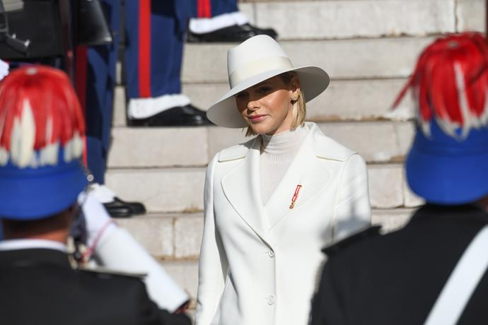 We're coveting the addition of a chic white hat.