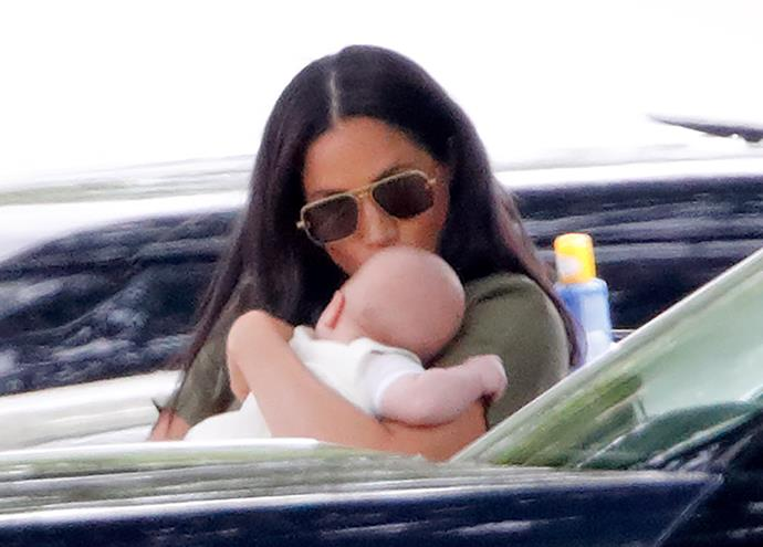 Doting mum Duchess Meghan was even snapped planting a kiss on the little one's head.