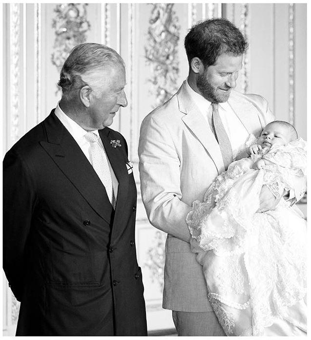 To celebrate Prince Charles' 71st birthday, Sussex Royal treated their followers to another unseen photo of Archie from his christening day with his beloved dad and grandpa.