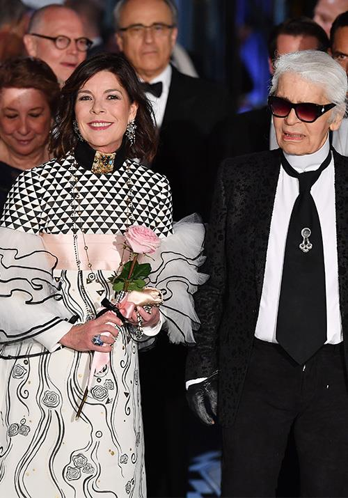 And she's never lost her sense of style. In 2017, the Princess was pictured next to fashion legend Karl Largerfeld wearing a chic printed frock that basically summed up Chanel.